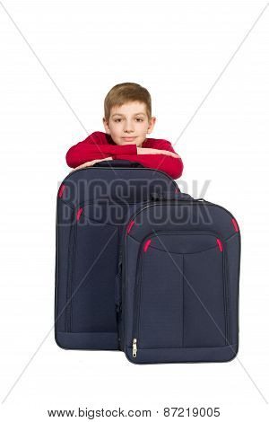 Portrait Of Boy With Travel Bags Isolated On White