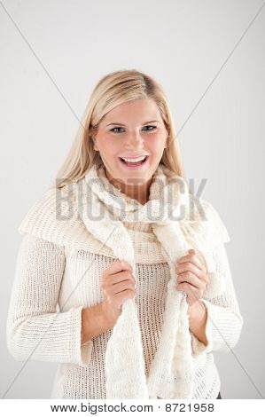 Seasonal portrait of pretty funny woman in hat and gloves smiling