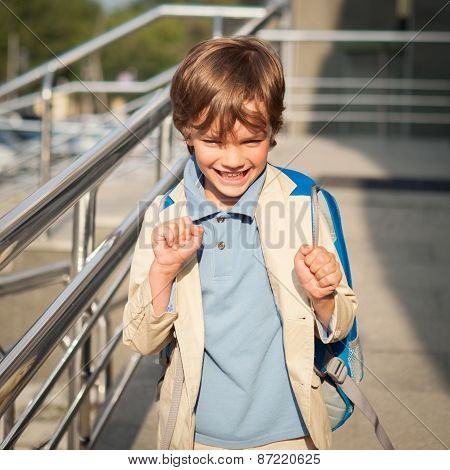 Portrait Of Happy Schoolboy With Backpack