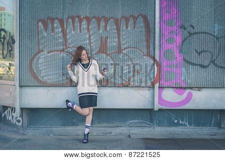 Beautiful Girl Texting In An Urban Context