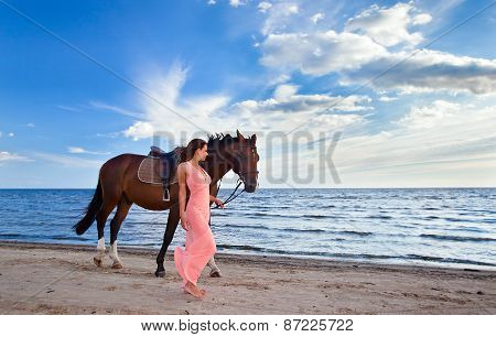 Woman With Horse On Seacoast