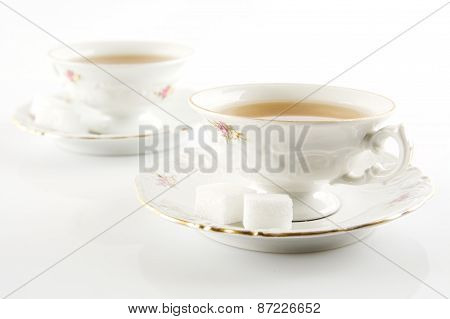 Old-style Vintage Two Cups Of Tea On White Background