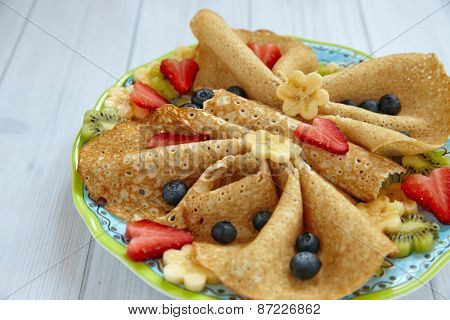 Funny butterfly shaped crepes with berries