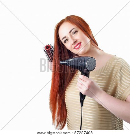 Redhead Woman With Long Hair Holding Hair Dryer And Comb