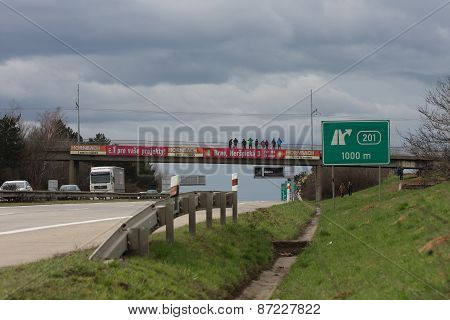 Highway in Brno, people on bridge welcome Dragoon Ride - US Army Convoy