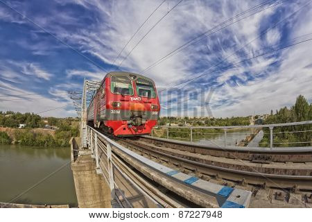 train goes on railway bridge through Volga-don canal