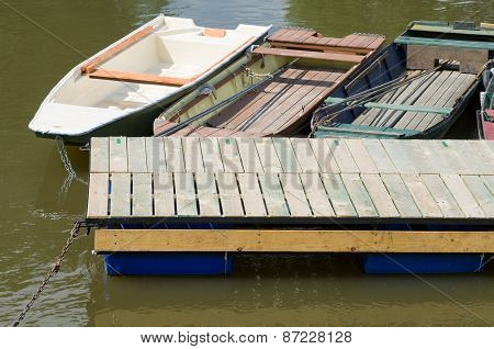 Moored Boats And Floating Pier