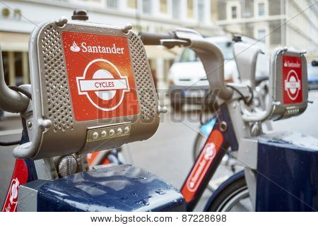 LONDON, UK - APRIL 02: Detail of Boris bikes in line. April 02, 2015 in London. On 27 February 2015. Mayor Boris Johnson secured Santander's sponsorship on the bike's scheme to replace Barclays bank.