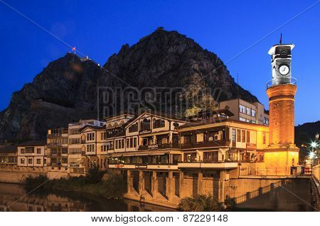 Clock tower view with the mountain which is in Amasya city center, Turkey