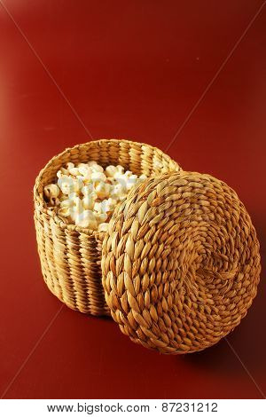 Popcorn On Red Background With Basket