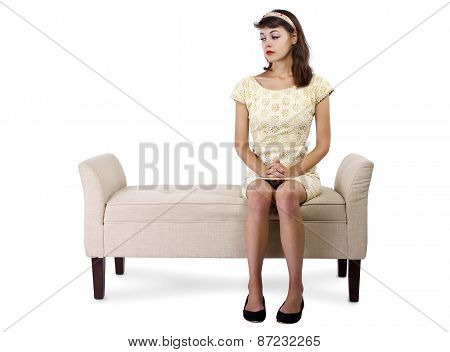Sad Girl Sitting and Waiting on a Chaise Lounge