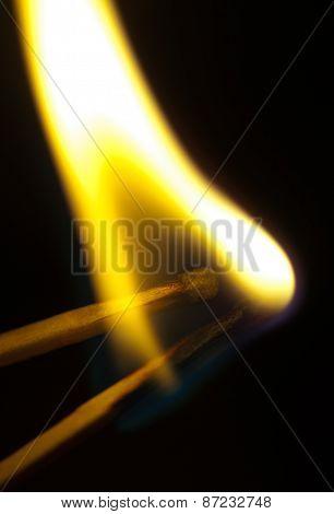 Burning Matchsticks On Black Background