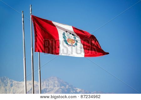 Peruvian Flag Waving In The Wind