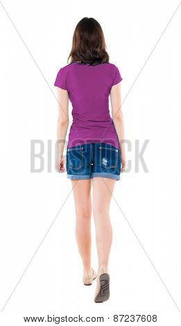 back view of walking  woman in shorts. beautiful brunette girl in motion.  backside view of person.  Rear view people collection. Isolated over white background.