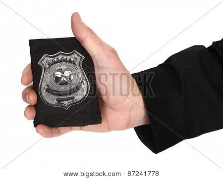 Man hand is holding special police badge