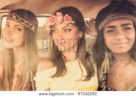Multinational hippie girls in a van