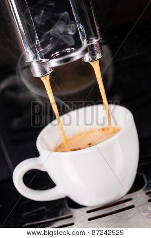 Detail of coffee machine making espresso