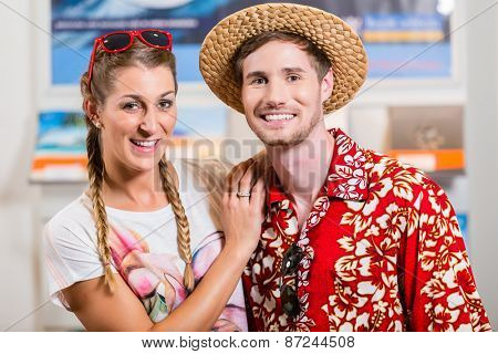 Tourist couple in travel agency