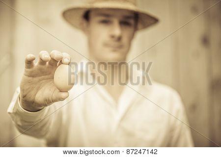 Farmer Showing An Egg