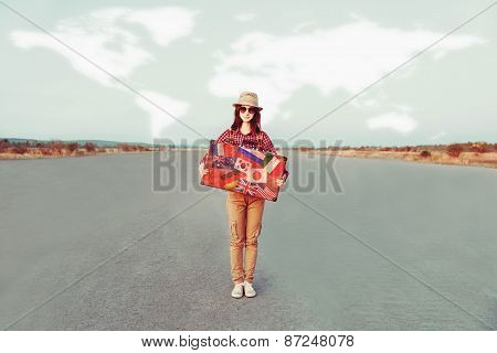 Smiling Traveler Girl Holding A Suitcase
