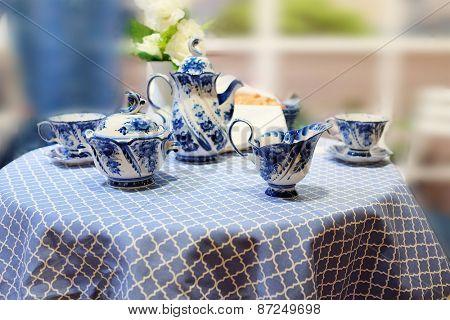 Set of milkman, teapot, cups, sugar bowl painted under Gzhel