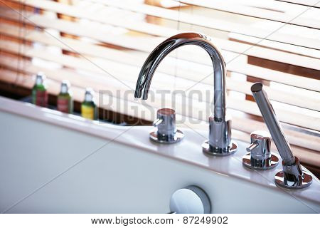 Faucet of whirlpool in bathroom, closeup