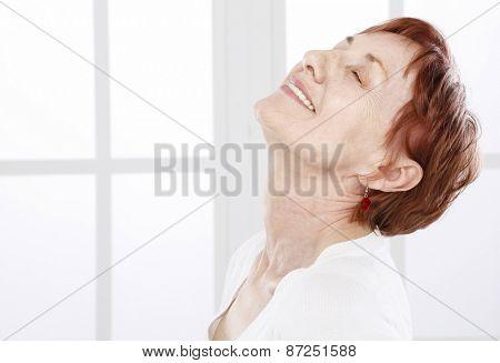Senior woman in positive attitude