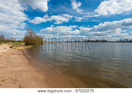 Sandy Beach At A River On A Beautiful Day