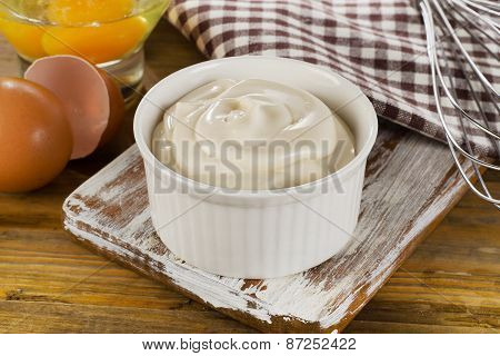 Mayonnaise In  A Bowl With Eggs  On  Wooden Background