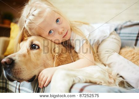 Cute child lying on fluffy pet