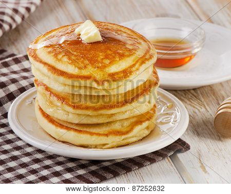 Stack Of Small Pancakes With A Maple Syrup