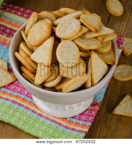 Crackers In White Bowl On  A Wooden Background