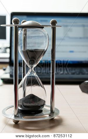 hourglass with laptop