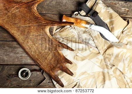 Hunting gear on wooden board, top view