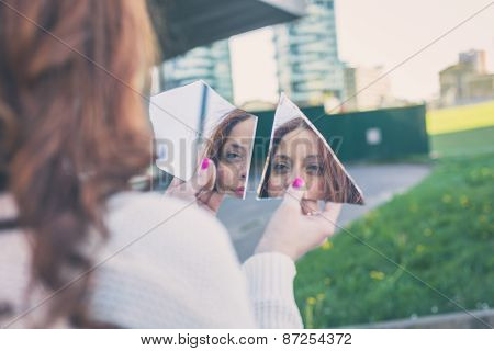 Beautiful Girl Looking At Herself In A Mirror