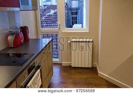 Part of kitchen and heating radiator