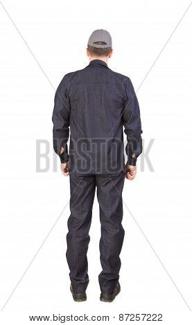 Worker in black workwear. Back view.
