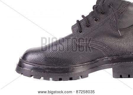 Close up of black working boot.
