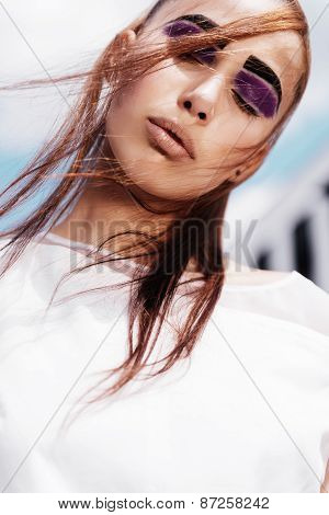 Portrait Of A Beautiful Brunette Girl With Enclosed Eyes On The Sky Background, Beauty Concept