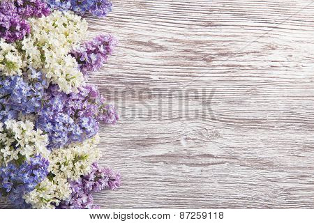 Lilac Flowers Bouquet On Wooden Plank Background, Spring Purple Blooming Bunch, Wood Texture