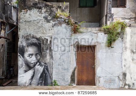 George Town,penang ,malaysia- Circa March 26, 2015: Public Street Black And White Boy Painting Stree