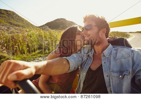 Woman Kissing Her Boyfriend Driving A Car