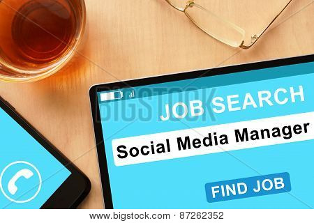 Tablet with Social Media Manager on job search site.
