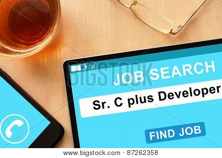 Tablet with Sr C plus Developer on job search site.