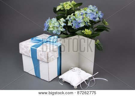 Blank Gift Card, Bouquet Of Hydrangea Flowers, Gift Box And Wedding Rings Over Grey