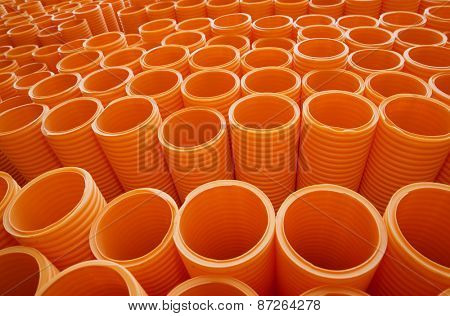 Large Group of Orange Industrial Plastic Pipes Full Frame