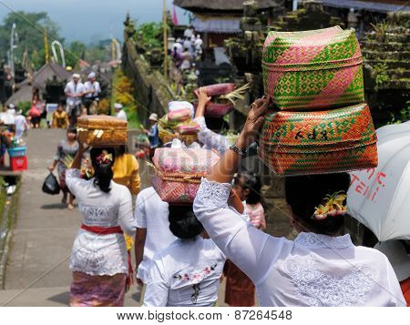The Woman Is Carrying Gifts For Hindu Gods On The Head In The Woven Baske