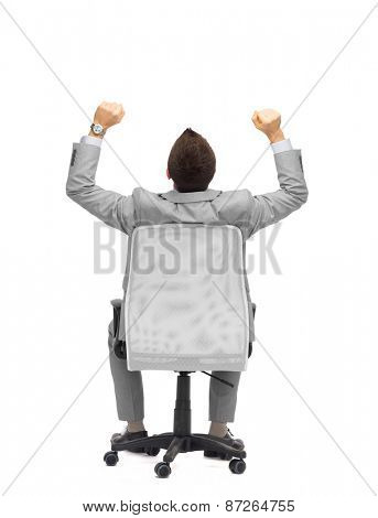 business, people, success and office concept - happy businessman sitting in office chair with raised hands from back