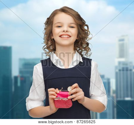 finances, childhood, people, money and savings concept - happy little girl with purse and euro coin over city background