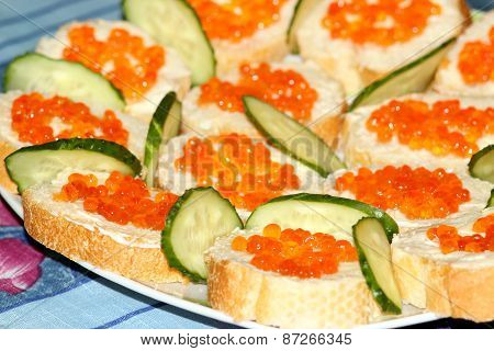 Sandwiches With Red Caviar And Cucumber